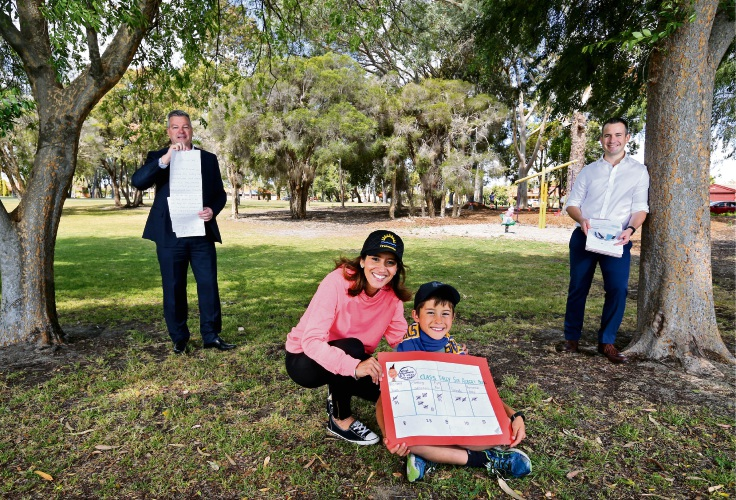 Nat and Chad Cameron (9) of Willetton with Councillors Patrick Hall (left) and Ben Kunze from the City of Canning, holding the letters they received from Chad. Picture: David Baylis.