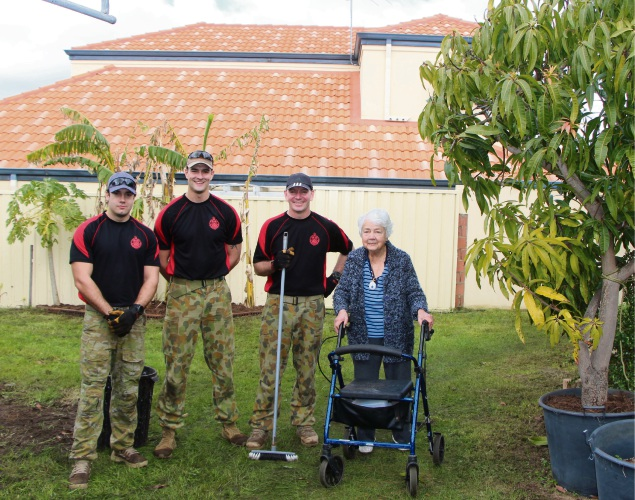 Captain James Clarke, Corporal James Dastlik and Warrant Officer Adam West with Eva Young