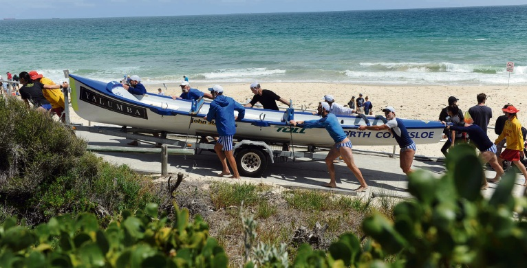 All chipped in to bring the surf boats off the beach.