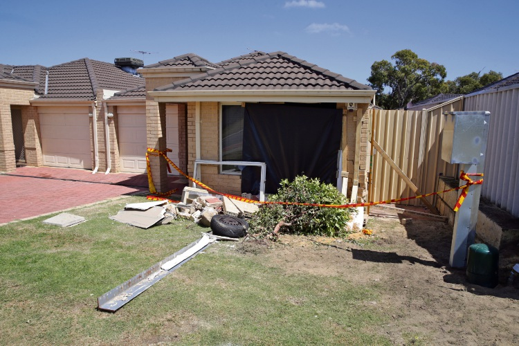 The house on Hillcrest Road, Alexander Heights, where a car crashed over the weekend. Picture: Martin Kennealey.