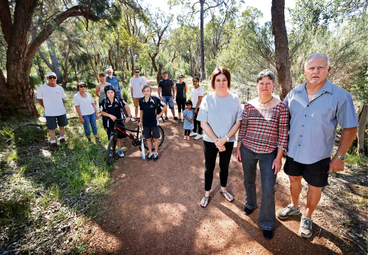 Foreground: Narelle Unger, left, Tracy Sandercock and Keith Mort seen here with other concerned local residents who formed a group called Community Advocates for Railway Reserve Kalamunda. Picture: David Baylis.