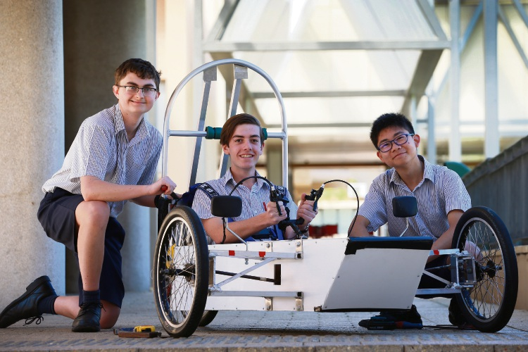 Year 11 Christ Church Grammar students Ben Lane, Mitchel Rocchi and Callum Koh are part of a 10-student team building and racing their own electric vehicles at the 2018 EV Challenge at the end of this month. Picture: Andrew Ritchie www.communitypix.com.au d487742a