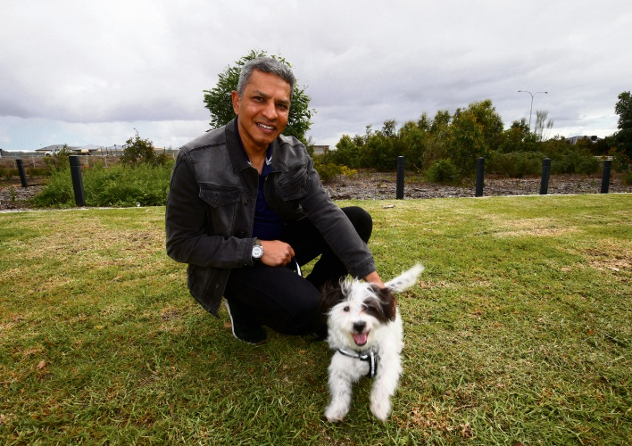 Local resident Shaun Kader with puppy Salty at the site of the future dog park in Piara Waters. Photo: Matt Jelonek d487808 communitypix.com.au