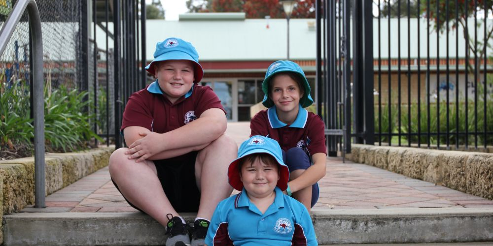 Clayton Primary School students Drew, Benjamin and Payton remember to slip, slop, slap, seek and slide when the UV is above three. Picture: Sunsmart.