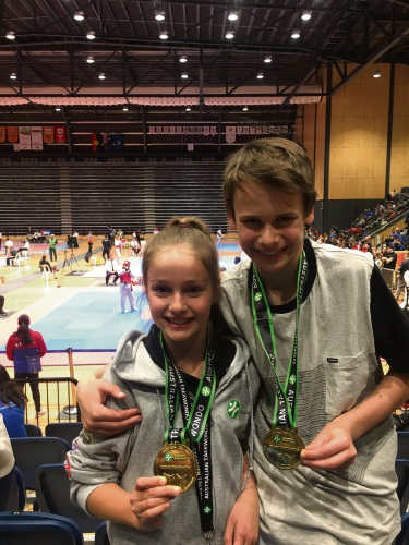 Hannah Wilkinson and Alex Thom with their gold medals.