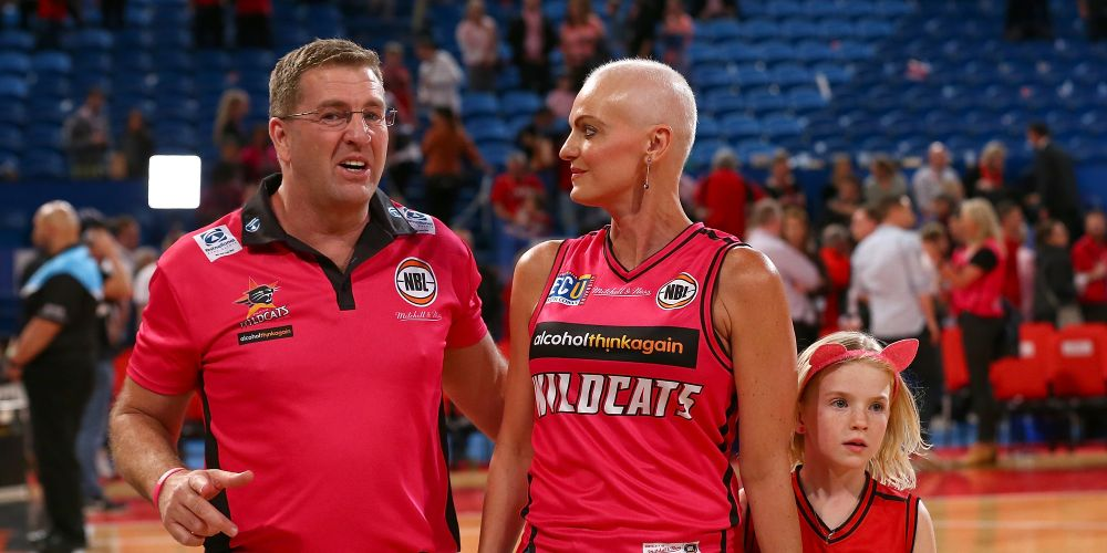 Trevor Gleeson walks from the court with his wife Dawn and their daughter Shae after winning last year's Pink Game against the Illawarra Hawks at Perth Arena. Picture: Paul Kane/Getty Images