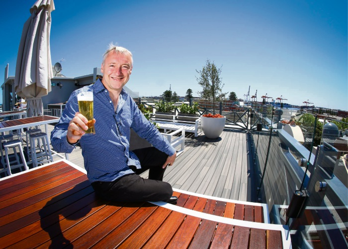 Karl Bullers toasts to the opening of the National Hotel's new rooftop bar. Photo: Matt Jelonek d487805 communitypix.com.au