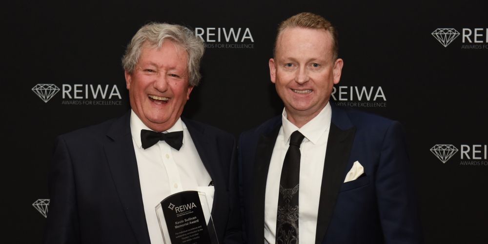 REIWA president Damian Collins (right) with Kevin Sullivan Memorial Award winner Ian Cornell.