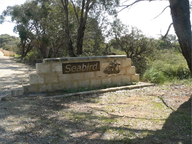The Seabird welcome sign pays homage to the Sea Bird wreck.