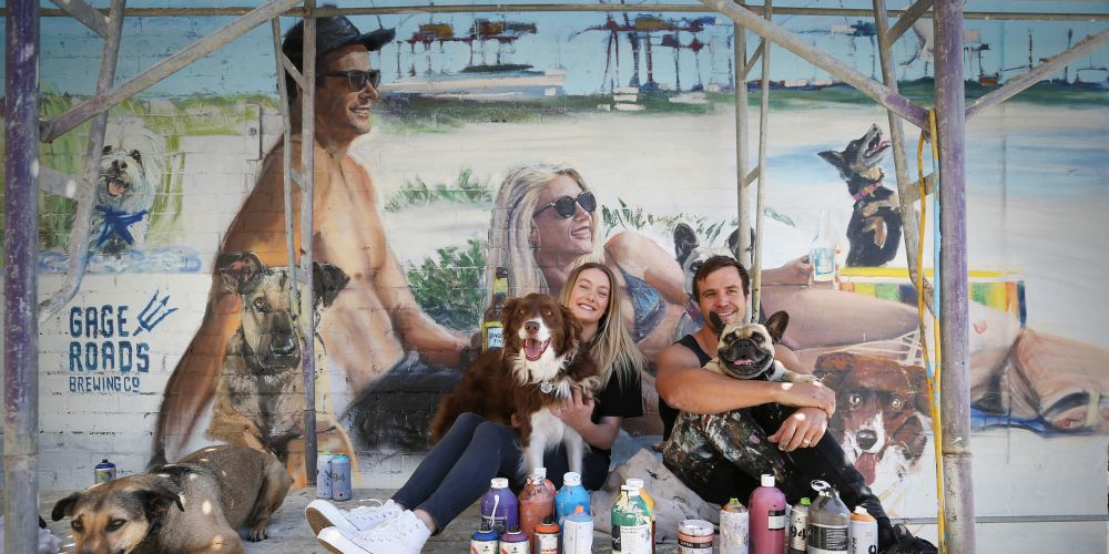 Elvis the dog, Sarah Viner with her dog Nero and artist Jacob Shakey Butler with his dog Banjo at Old Bridge Cellars. Photo: Andrew Ritchie