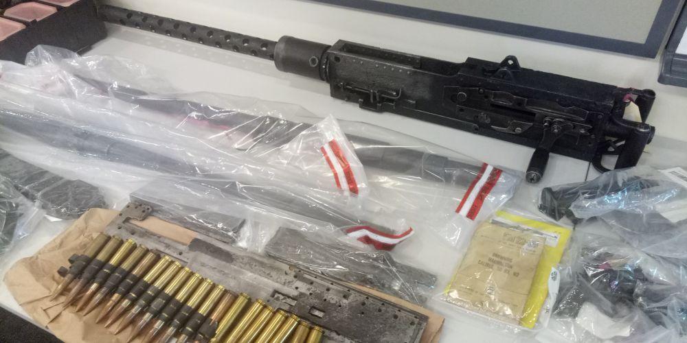 Machine gun found among firearm hoard in Belmont