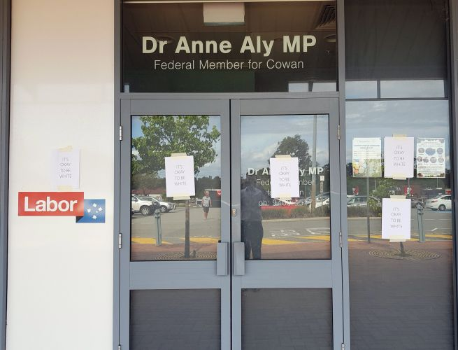 Perth: office of MP Dr Anne Aly covered with 'it's okay to be white' posters