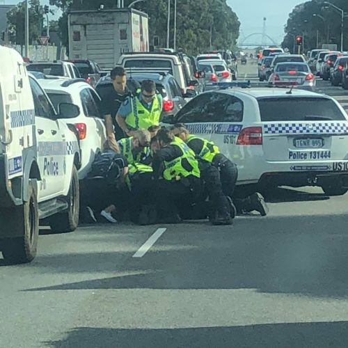 There was a dramatic arrest on Mandurah Road this morning. Photo by Gareth Millard.