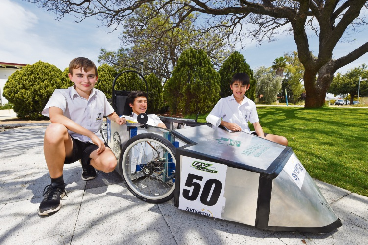 Melville Senior High School students Aaron Benness, Brian Caffrey and Steven Phillips with their electric car. Picture: Jon Hewson