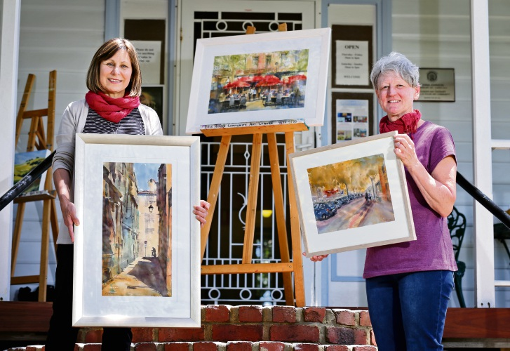 Watercolour artists Gerri Box and Sue Hibbert getting ready for the French Impressions Exhibition at Ellis House Community Arts Centre. Picture: David Baylis www.communitypix.com.au d488003