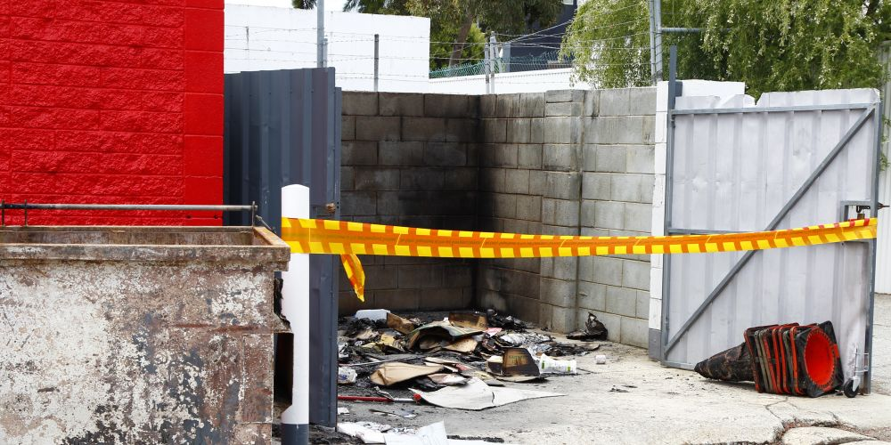 A bin was set on fire at the back of Coles Express on Marangaroo Drive. PIcture: Marie Nirme d488228