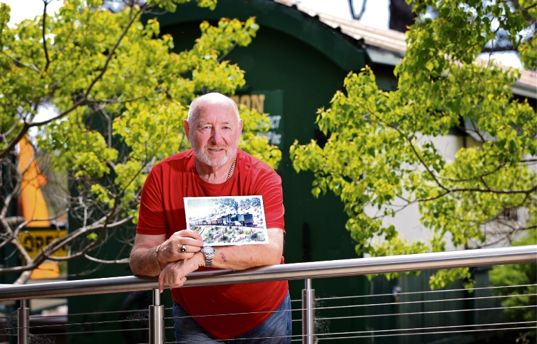 John Edmonds of Orange Grove (Member Kalamunda Rate Payers Association), seen here with a picture that depicts the old Zig Zag Railway. Photo: David Baylis