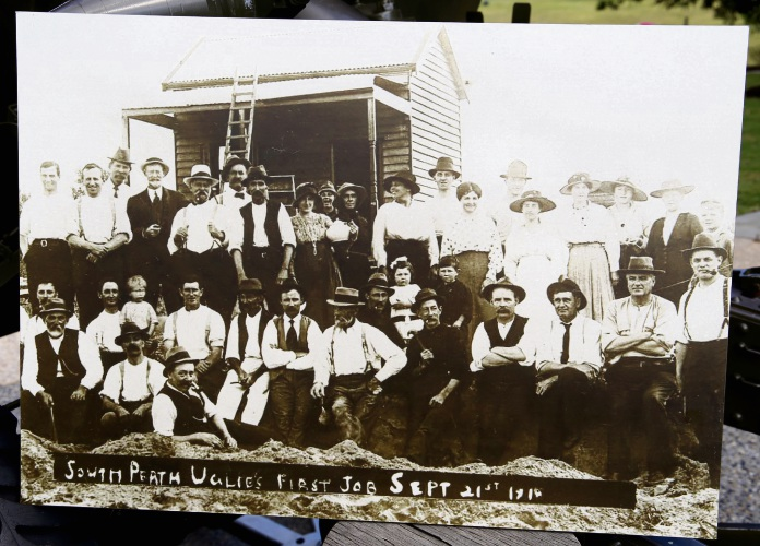 Taken in 1918, this photograph shows members of the South Perth Ugly Men Association in front of a house they built in Arlington Avenue.