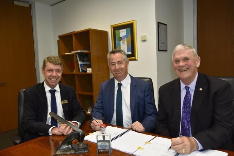City of Cockburn CEO Stephen Cain, New Energy Corporation CEO Jason Pugh and City of Cockburn Mayor Logan Howlett sign the Energy from Waste agreement.