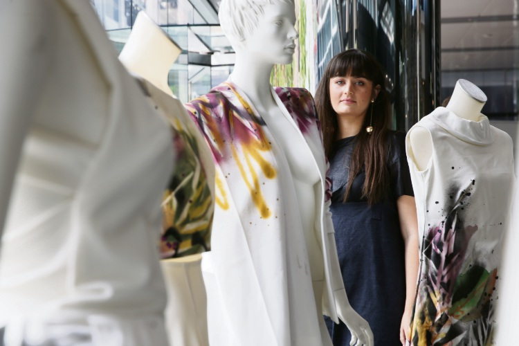 Artist Ariel Katzir has created a clothing collection live in Brookfield Place ahead of the Melbourne Cup. Picture: Andrew Ritchie