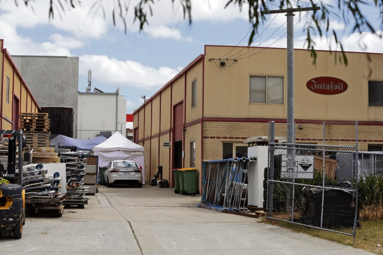 Detectives investigating the industrial site on Mooney Street, Bayswater on November 5. Photo: Martin Kennealey