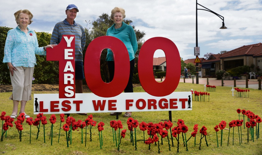Ridgewood Rise Village residents Edna Johanson, Jim Tailor and Maureen Fagg have created a roadside tribute to mark the Armistice Centenary. Picture: Martin Kennealey.