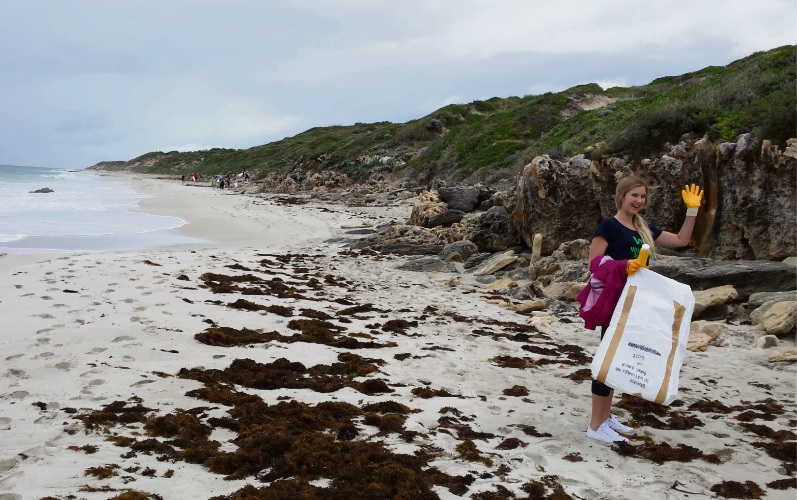 Brooke Fennell cleaning up Burns Beach.