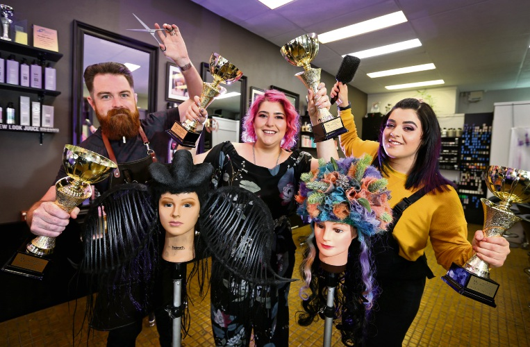 Matthew Simpson (Barber), Elizabeth Stillisano (Owner, Eclectic Styles Hair Studio) and Jo Milieri (1st year Apprentice), seen here with their awards and hair designs. Photo: David Baylis