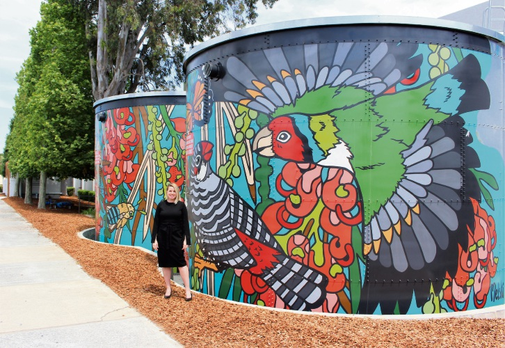 Belmont Forum centre manager Alexandra McAuliffe in front of the public-contributed art mural.