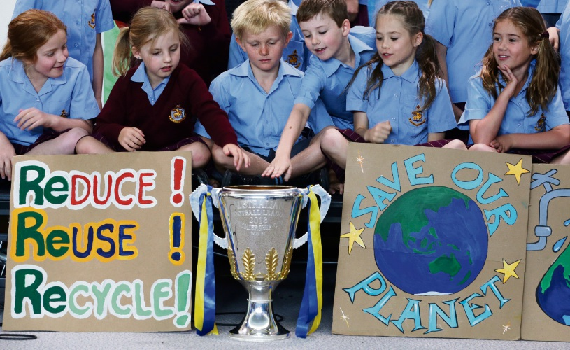 St Mark's Anglican Community School students with the premiership cup. Photo: Martin Kennealey