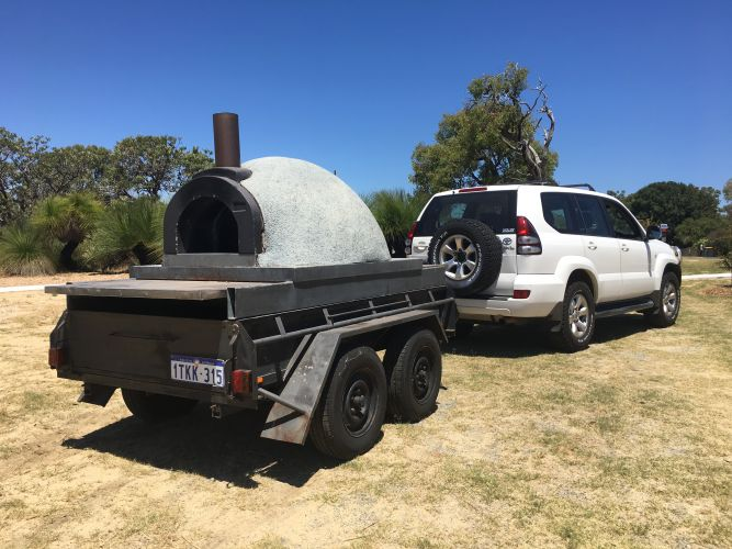 The stolen pizza oven and trailer.
