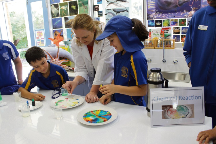 Dalmain Primary School students Ben Fourie and Hayley Stopher check out chemical reactions with Kingsley MLA Jessica Stojkovski.