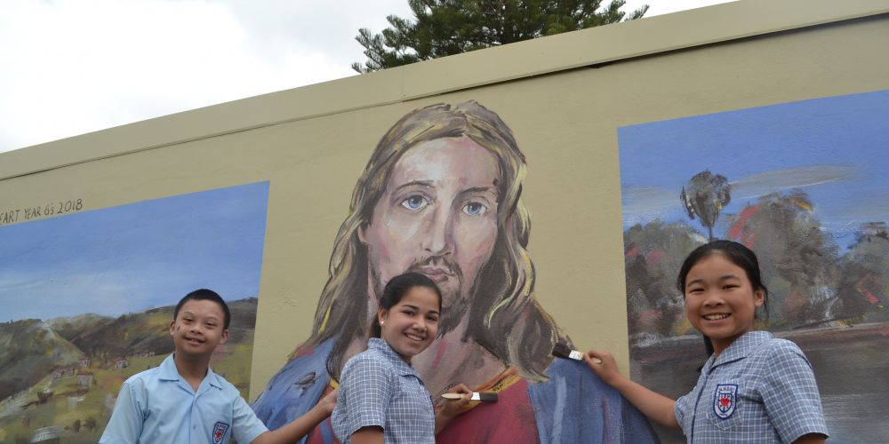 Year Six students Raphael Chavez, Lia Ottobrino and Nina Nguyen at the mural. Picture: Jessica Warriner.