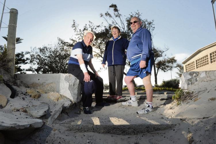 Senior swimmers (l-r) John Deacon (86), Eleanor SgherzaOK (82) and Leo Monaco (82) have to negotiate degraded steps at Port Beach.  Picture: Jon Bassett.