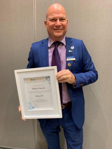 Principal Dean Finlay with the Fellowship Award.