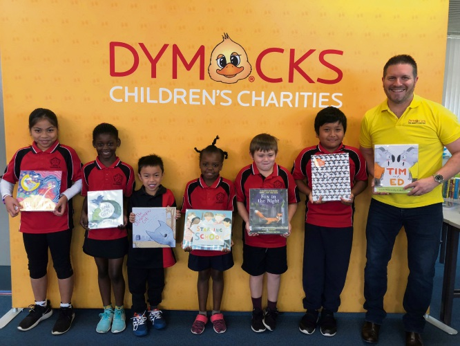 Southwell PS students Jeane, Niyera, Jil, Azori, Antonio and Mike with Dymocks Children's Charities board member Paul Swain.