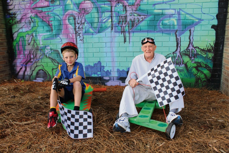 One Tree Community Services attendee Oliver Horley (8) and Canning Men's Shed founder and vice-president Eddie Holmes. Picture: Aaron Corlett.