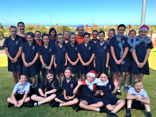 Choir director Chistina Claire with St James' Anglican School junior choir.