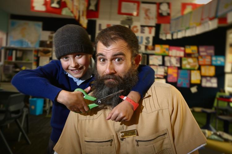 Levi Surjan (12) and teacher Steven Carrabs. Photo: Andrew Ritchie. d488451 communitypix.com.au.