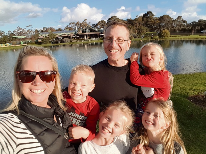 Kylie and Chris Shaw with their children on their last family holiday.