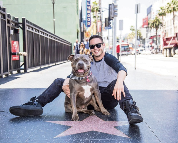 Filmmaker Jon Mancinetti and his dog, Smokey.