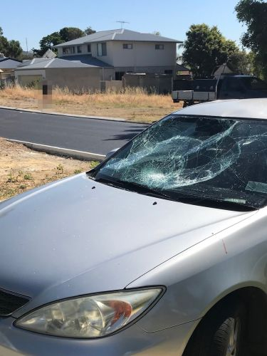 The damage to a car after it collided with a student cyclist in Woodlands. Picture: Greg Odgers.