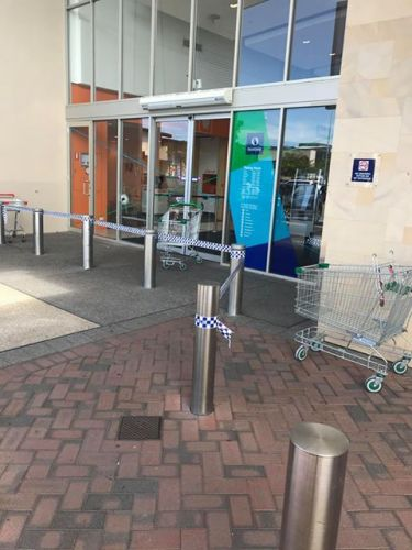 Police tape around the shopping centre. Photo by James Barton.