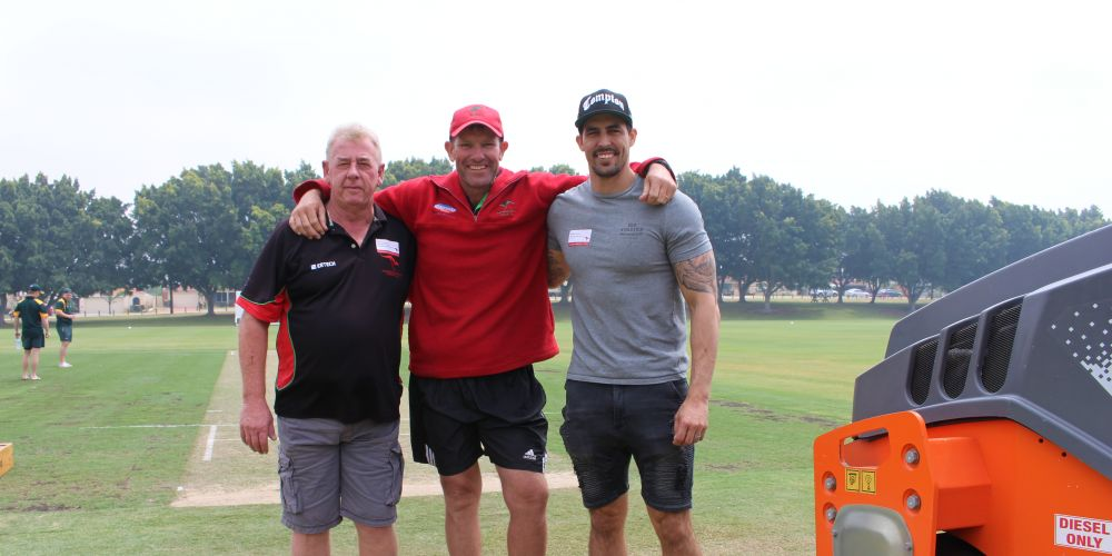 Former Wanneroo president Norm Fawcett and curator Vin Clarke with Roos' former Test paceman Mitchell Johnson. Picture: J Bianchini