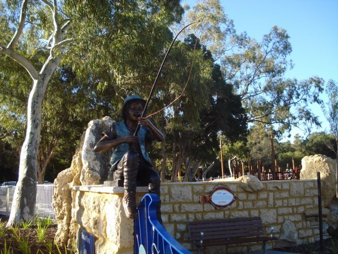 The fishing boy statue.