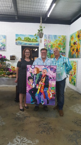 Darryl and Heather Milne with the winning auction artwork and artist Dave Calkins.