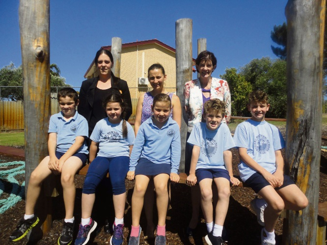 Back left to right: Bankwest's Sharon DeSousa, P&C President Kacey Bartlett and Principal Linda Humphreys. Front left to right: Haro Bartlett, Alyssa DeSousa, Indy Bartlett, Riley Nickson, Angus Nickson in their growing nature play area.