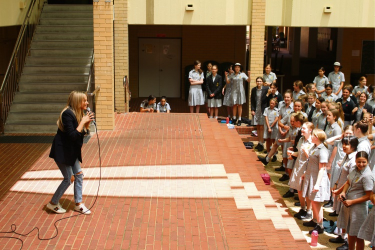 Samantha Jade performing to Penrhos College students in the courtyard.