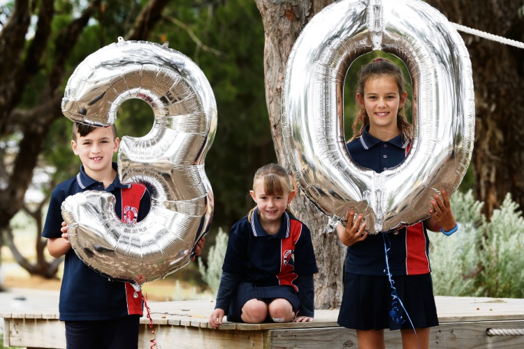 Ocean Reef Primary School students Zac Mettam, Lily Rose McSwain and Sophia Backhouse are gearing up for their 30th anniversary fete. Picture: Martin Kennealey d488775