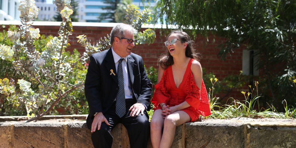 Craig Lawrence with Lauren Gilbride reunited after Craig saved Lauren from a vehicle crash. Photo: Matt Jelonek